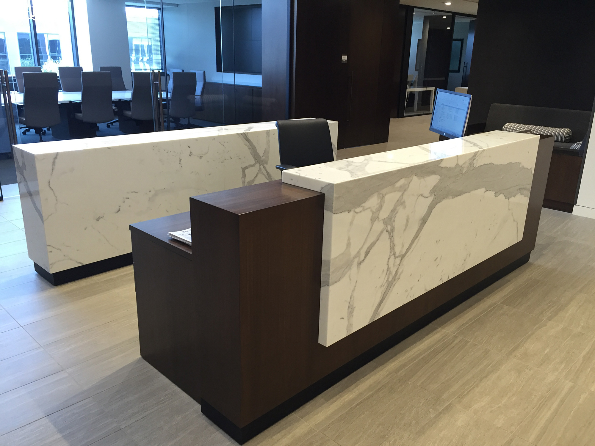 Stone waterfall reception desk and credenza